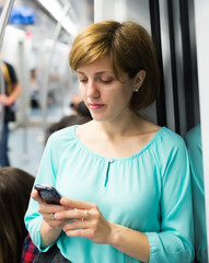 Female passenger using smartphone