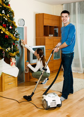 Adult couple cleaning in home