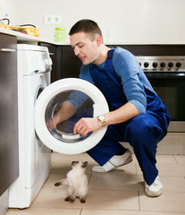 Repairman repairing washing machine