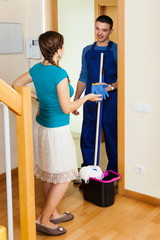 Woman meeting cleaner at door