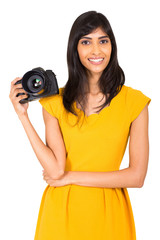 female photographer holding a camera