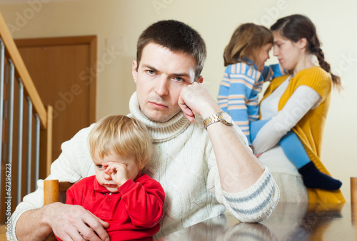 Young family conflict. Upset  man against sadness woman