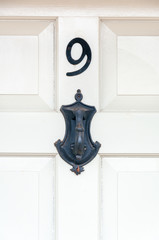 Number 9 and door knocker close up