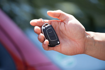 Man Holding Car Key Outdoors