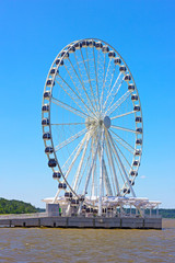 Ferris wheel on the water edge.
