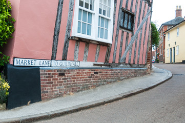 Close up of sign and road to Guildhall in Lavenham, Suffolk, UK