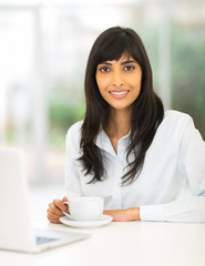 indian businesswoman drinking coffee
