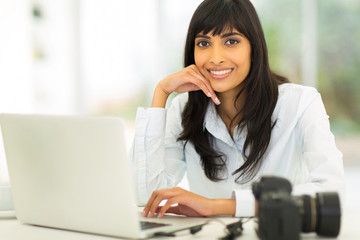 female photographer sitting in office