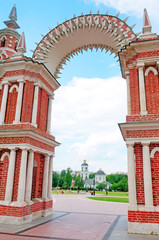Arch of red brick decorated with white pattern