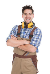 Smiling Worker Standing Arms Crossed Over White Background