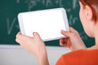 Woman Using Digital Tablet In Classroom