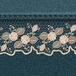 Denim background with white lace ribbon.