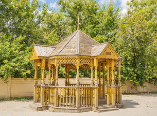 Carved wooden gazebo in the city park