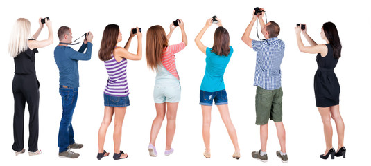 Back view group of people photographed attractions.