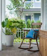 Leinwandbild Motiv wooden rocking chair on front porch with pillow