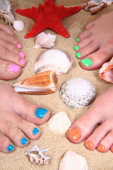 pedicure (color nails) on the beach