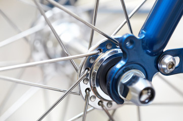 fragment of a bicycle wheel with shallow depth of field