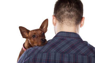 Small dog lying on the shoulder of his owner