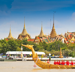Barge parades past the Grand Palace at the Chao Phraya river