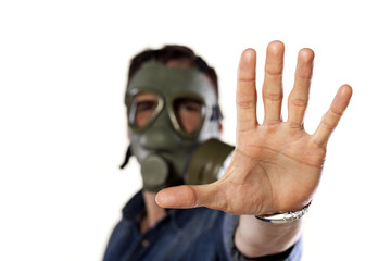 man with a gas mask showing with his hand a stop sign
