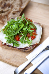 Toast with bacon, cheese, tomato and green salad