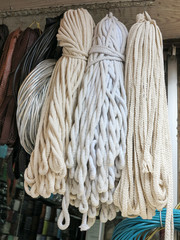 Bundles of white ropes hanging in a small shop, Istanbul, Turkey