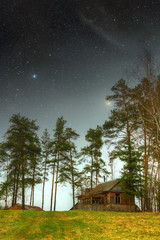 country house at night. Elements of this image furnished by NASA