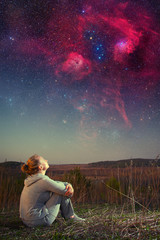 girl and a starry sky. Elements of this image furnished by NASA