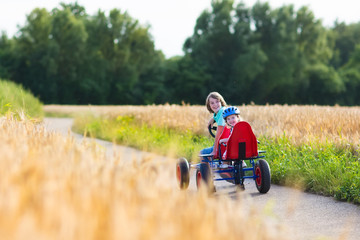 Kids having fun with a go cart car