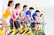 canvas print picture - Asian people in spinning bike training at fitness gym