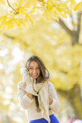 Young woman in the autumn forest