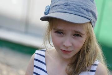Blonde young kid in denim cap