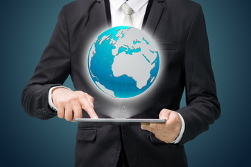 Businessman standing posture hand hold globe map on tablet
