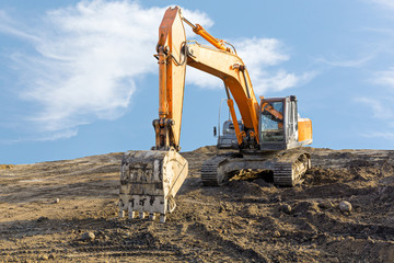 Big excavator on construction site