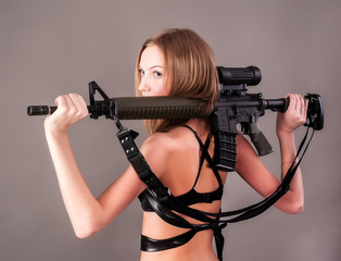Attractive woman holding sniper rifle