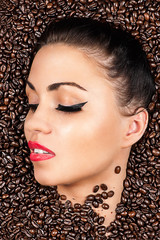woman face with closed eyes in the coffee beans