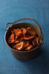 Aromatic, dried orange potpourri leaves