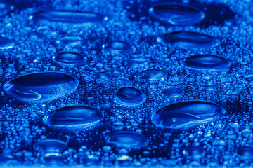 blue water drops on the surface