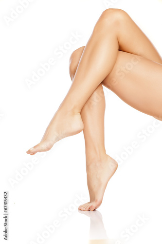 canvas print picture pretty female legs on white background
