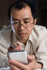 Asian businessman using cellphone