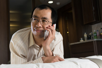 Asian businessman using cellphone