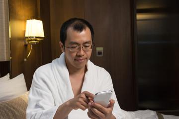 Mature Asian man in bathrobe