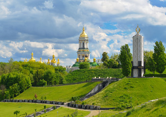 Monument to victims of Holodomor and Kiev-Pechersk Lavra in Kiev