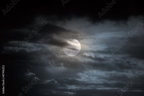 Overcast full moon night