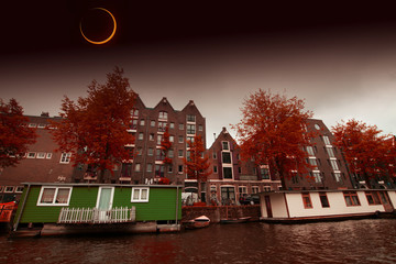 Solar Eclipse over the city Amsterdam. Elements of this image fu