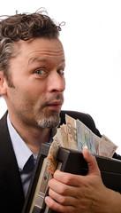 Mann mit einem Geldkoffer