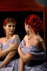 Retro model looking in the mirror