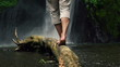 Man walking on wood log by waterfall, super slow motion, 240fps