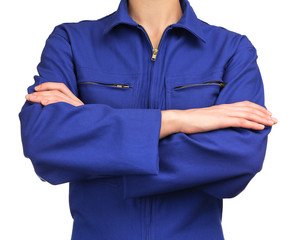 woman in blue work uniform with arms crossed