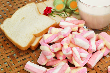 fresh milk and pink marshmallows with a slice of bread.